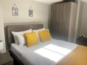 A bed or beds in a room at The Works Apartments Liverpool