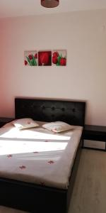 A bed or beds in a room at Sofia Garden House with BBQ, close to Tube/Metro Station