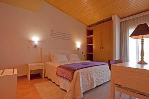 Uma cama ou camas num quarto em Herdade da Urgueira