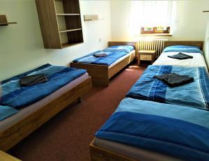Postel nebo postele na pokoji v ubytování Chata Šumná