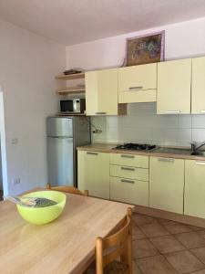 A kitchen or kitchenette at Residence Olimpo apartments