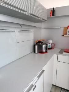 Una cocina o zona de cocina en Gloria's House