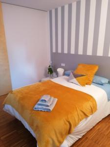 Cama o camas de una habitación en Gloria's House