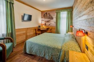 Uma cama ou camas num quarto em Hotel Corona