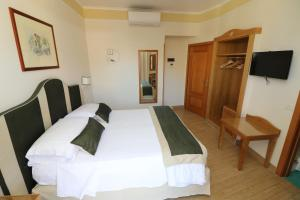 A bed or beds in a room at Hotel Tourist