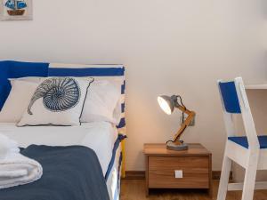 Een bed of bedden in een kamer bij Il Profumo del Mare