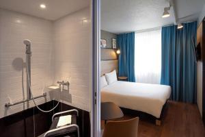 Ein Bett oder Betten in einem Zimmer der Unterkunft ibis Orléans Nord Saran