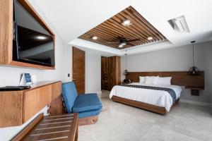 Cama o camas de una habitación en Ocean Dream Cancun by GuruHotel