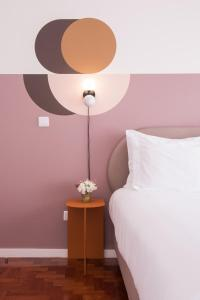 A bed or beds in a room at Lisbon Serviced Apartments - Campos