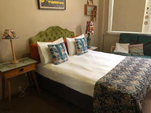 A bed or beds in a room at Vine Valley Inn