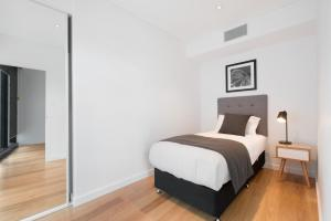 A bed or beds in a room at Arise Brisbane Skytower