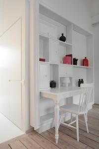 A kitchen or kitchenette at Maison Nationale City Flats & Suites