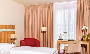 Кровать или кровати в номере Welcome Hotel Darmstadt