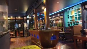 The lounge or bar area at Foresto Sukhothai Guesthome