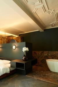 Een badkamer bij Nonam Boutique Hotel