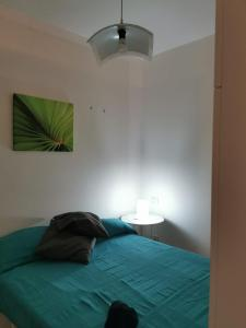 A bed or beds in a room at Guerrero Rooms