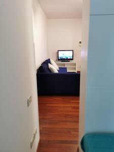 A television and/or entertainment center at Guerrero Rooms