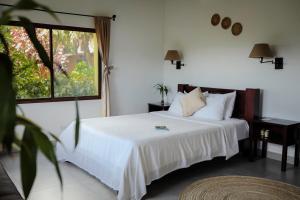 A bed or beds in a room at The Golden Frog Inn