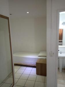 A bed or beds in a room at FICARE POA - 3min do Complexo Hospitalar Santa Casa