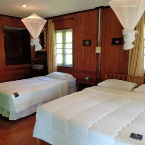 A bed or beds in a room at Suntisook Resort