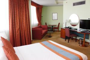Cama o camas de una habitación en Al Diar Dana Hotel