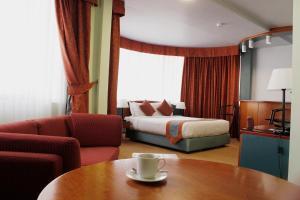 Zona de estar de Al Diar Dana Hotel
