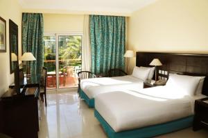 Кровать или кровати в номере Sierra Sharm El Sheikh