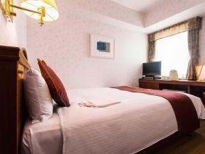 特拉斯特名古屋酒店房間的床