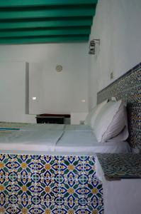 A bed or beds in a room at Hôtel Djerba Erriadh