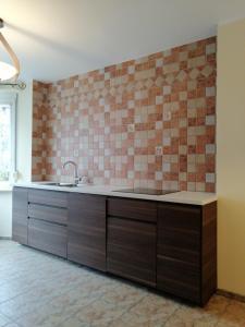 A kitchen or kitchenette at Apartament na doby