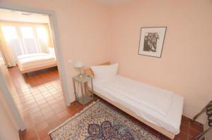 A bed or beds in a room at Altstadtliebe Salzuflen