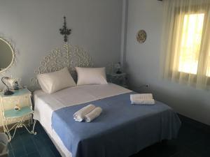 Кровать или кровати в номере Fteroti house