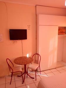A television and/or entertainment centre at FICARE POA - 3min do Complexo Hospitalar Santa Casa