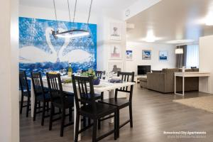 A restaurant or other place to eat at Rovaniemi City Apartments