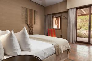 A bed or beds in a room at Alto Atacama Desert Lodge & Spa (All-inclusive)
