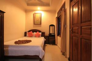 A bed or beds in a room at Duana's Homestay