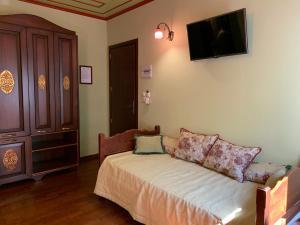 Ένα ή περισσότερα κρεβάτια σε δωμάτιο στο Ξενώνας Έλενα