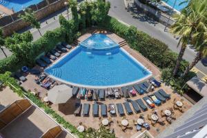 O vedere a piscinei de la sau din apropiere de Hotel Acapulco