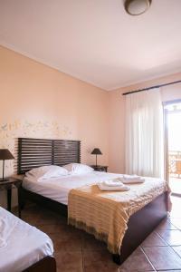 Кровать или кровати в номере Ammon Garden Hotel