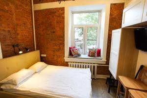 Кровать или кровати в номере Lounge&Smile on Rubinshteina