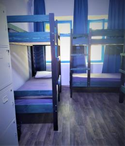 A bunk bed or bunk beds in a room at Tapok Hostel