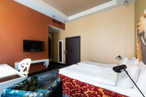 A bed or beds in a room at Radisson Sonya Hotel
