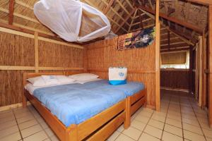 A bed or beds in a room at Pine Beach Pakostane - All Inclusive light