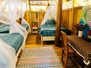 A bed or beds in a room at Pu Luong Riverside Lodge