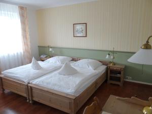 Ein Bett oder Betten in einem Zimmer der Unterkunft Landhaus Schulze-Hamann