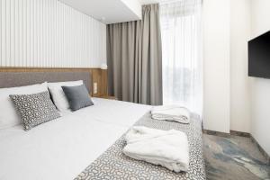 Łóżko lub łóżka w pokoju w obiekcie Maloves SPA & Resort