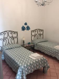 A bed or beds in a room at Casa Mulini