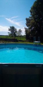 The swimming pool at or near La Cour d'Enchère