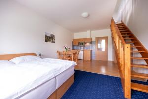 A bed or beds in a room at Apartmány Engadin
