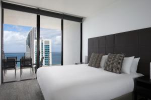 A bed or beds in a room at Mantra Circle On Cavill